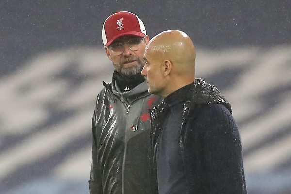 """Liverpool manager Jurgen Klopp (left) and Manchester City manager Pep Guardiola in discussion during the Premier League match at the Etihad Stadium, Manchester. PA Photo. Picture date: Sunday November 8, 2020. See PA story SOCCER Man City. Photo credit should read: Martin Rickett/PA Wire. RESTRICTIONS: EDITORIAL USE ONLY No use with unauthorised audio, video, data, fixture lists, club/league logos or """"live"""" services. Online in-match use limited to 120 images, no video emulation. No use in betting, games or single club/league/player publications."""