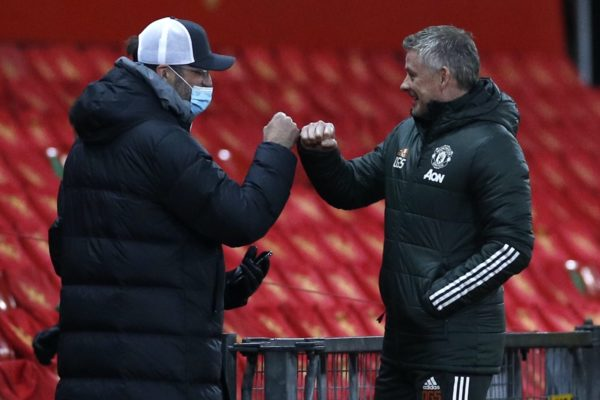 Liverpool manager Jurgen Klopp (left) fist bumps Manchester United manager Ole Gunnar Solskjaer (right) before the Emirates FA Cup fourth round match at Old Trafford, Manchester. Picture date: Sunday January 24, 2021.