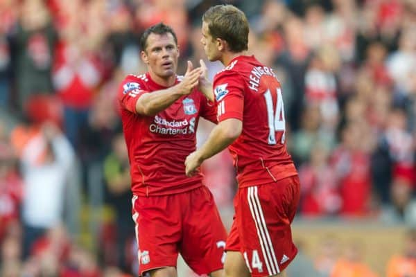 LIVERPOOL, ENGLAND - Saturday, August 27, 2011: Liverpool's Jordan Henderson is congratulated by team-mate Jamie Carragher as he is substituted against Bolton Wanderers during the Premiership match at Anfield. (Pic by David Rawcliffe/Propaganda)