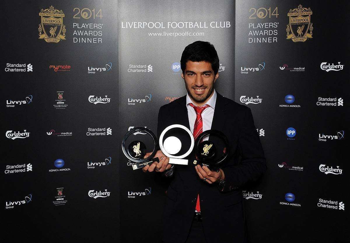 Luis Suarez of Liverpool poses with award during the Liverpool FC 2014 Players' Awards Dinner on May 6, 2014 in Liverpool, England.